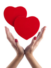 Red hearts in hands