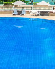 Table set on luxury terrace, pool side.