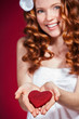 Portrait of a beautiful young woman holding Love symbol red hear