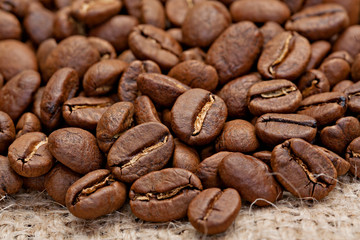 Roasted coffee beans on the sacking