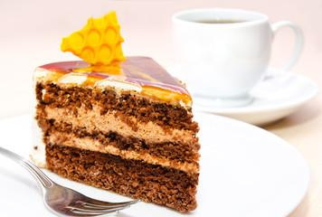 Piece of honey cake on plate