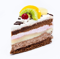 Piece of chocolate cake with icing and fresh fruit isolated on a