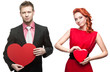 young handsome man holding red heart and cheerful woman on white