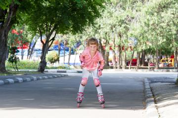 happy child girl roller skating