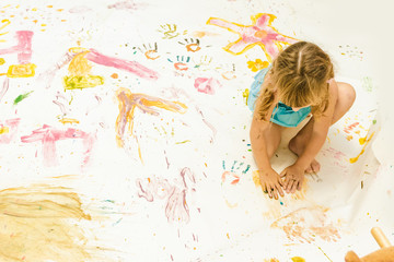 cute young child boy painting over white