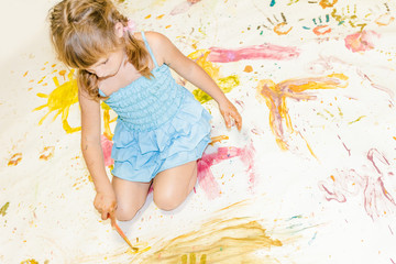 cute young child girl painting over white
