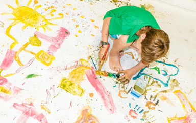 child boy painting over white
