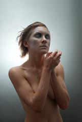 Frozen young woman in studio
