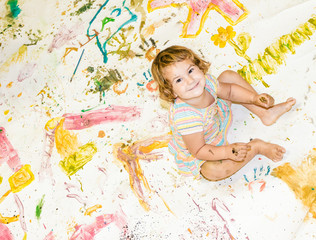 happy child girl painting over white