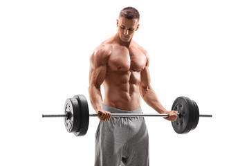 Handsome bodybuilder exercising with a barbell
