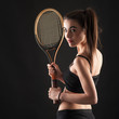 Sporty young woman portrait with tennis racket isolated against