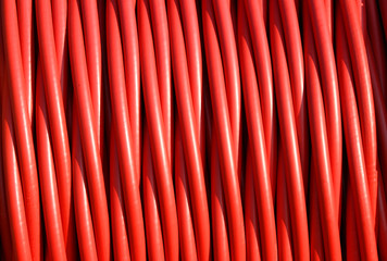 background of red electric cable insulating rubber