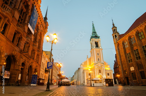 Fototapeta Early morning in Old Town of Torun, Poland. City Hall