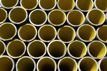 yellow corrugated tube for laying electric cables in the yard