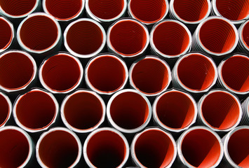 red corrugated pipes for laying electric cables and optical fibe