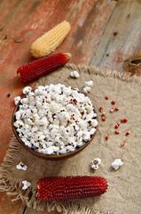 Bowl of popcorn with corncob.