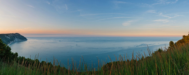 Panoramic view of Portonovo beach at sunset. Ancona, Marche, Ita