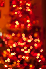 Christmas tree bokeh background. Glitter and light abstract.