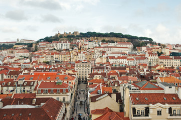 Beautiful view of old city from Santa Justa terrace with cloudy