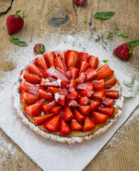 Strawberry cheesecake on a wooden background