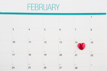 Red heart shape on Valentine's Day date on a calendar