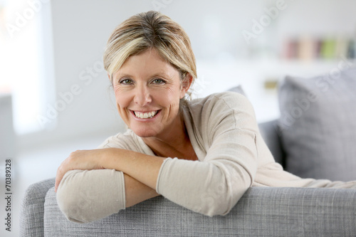 canvas print picture Beautiful 40-year-old woman relaxing in sofa