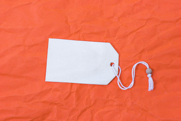 Wooden copy space on orange crumpled paper background