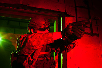 Special forces soldier or contractor during night mission