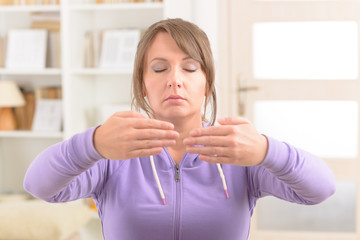 Woman doing qi gong tai chi exercise