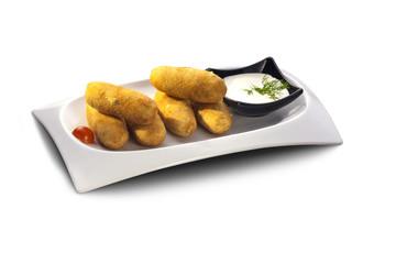 Delicious potato croquettes with sauce