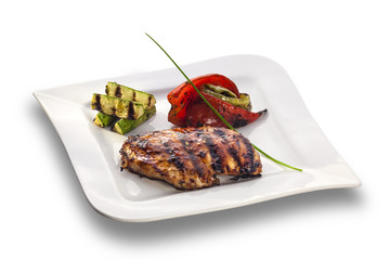 grilled chicken steak and roasted vegetables