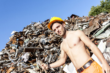young worker in a junkyard
