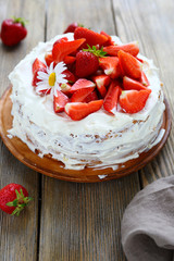 homemade round cake with strawberries