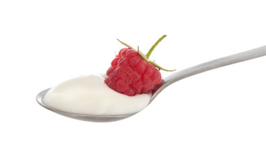 Natural organic yoghurt, yoghourt on spoon with raspberry