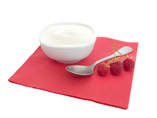 Natural organic yoghurt, yoghourt on red napkin with raspberries