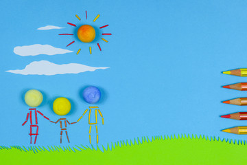 Figurative family holding hands on a sunny day against blue sky