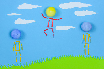 Figurative people standing on grass against blue sky.