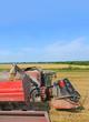 Overloading grain harvester
