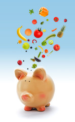 Piggy bank with fruits and vegetables