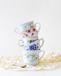 Stack of vintage tea cups for high tea - 70392179