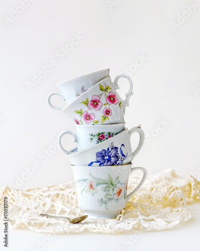 Stack of vintage tea cups for high tea - 70392179