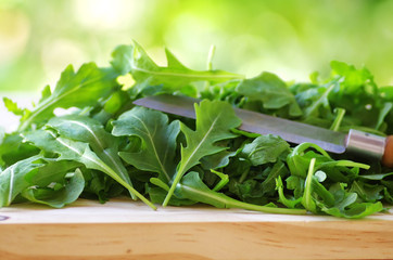 Rucola leaves and knife close-up