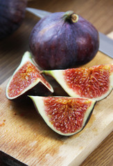 Beautiful ripe fresh pulpy figs on the table