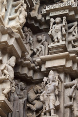 Detail of an erotic carving on a temple in Khajuraho, India.