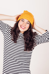 Happy autumn or winter girl with wool cap