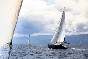 Luxury yacht at ocean race in stormy weather. Sailing regatta.