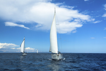 Yachting in the wind through the waves. Sailing. Luxury yachts.
