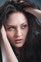 Studio portrait of model. Natural skin. No retouch.