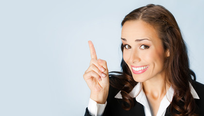 Businesswoman showing blank area for copyspace