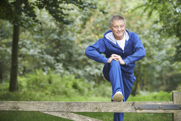 Senior Man Stretching On Countryside Run